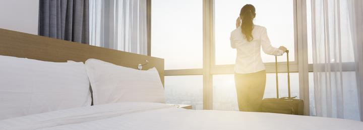 Woman looks out of hotel window